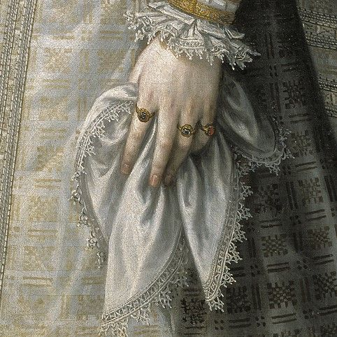 Dettagli 3. Alonso Sancgìhez Coello: Infanta Isabella Clara Eugenia. Olio su tela del 1579. Museo del Prado, Madrid. Il fazzoletto ha lo stesso bordino a piccolo tombolo della camicia che spunta dalla manica. Bella la trama geometrica oro e bianco del tessuto.
