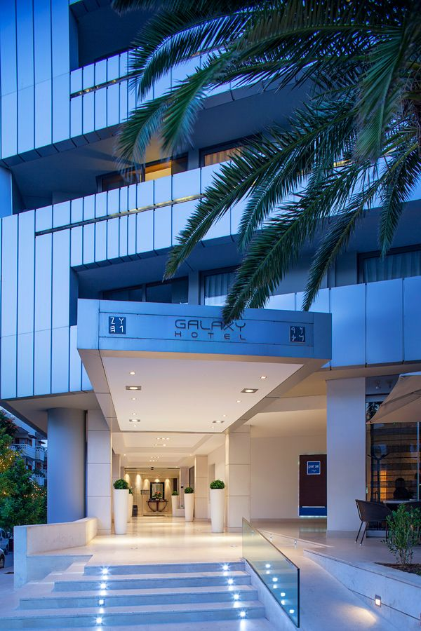 Galaxy entrance lit 39 hanging 39 canopy with linear for Hotel entrance decor