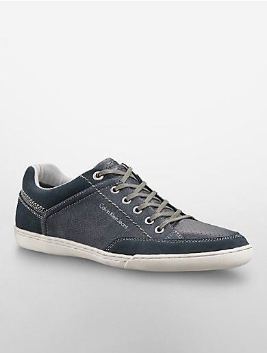 the calvin klein jeans chandler sneaker features a canvas and faux leather pattern and lace-up style.