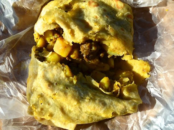 Goat roti, loaded with potatoes, onions. This tasty meal can be found at the Roti Hut on Edwin Wallace Rey Drive.