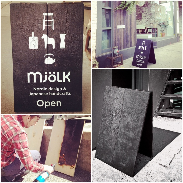 An unique burnt-wood sandwich board by Mjölk.