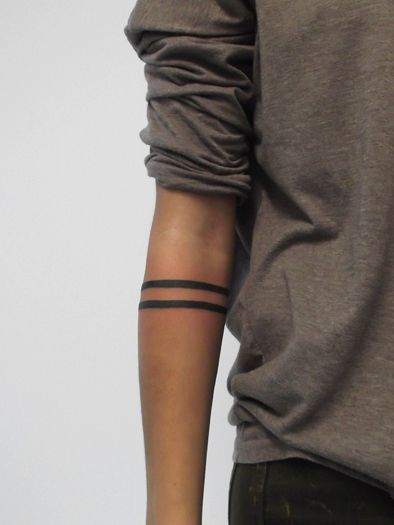 Simple and classy two black rings tattooed on a forearm. For some reason, I really like this.