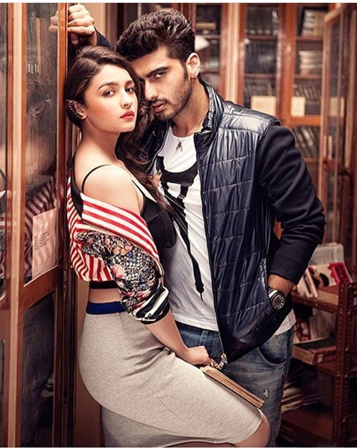 The Smoking Hot Jodi: Alia & Arjun We loved watching them in 2 States! Here is a pic of the duo to make us refresh our memories Glam Gal - Alia Bhatt . Rocking all the hot trends of the season in one look. The stripes in white and red with printed sleeves fit flawlessly on her figure. The grey skirt hugs her body perfectly making us envy her flawless toned figure. The book in her hand remind us of her Student of the Year avatar as a school going girl. The silver ear-cuffs look sexy.