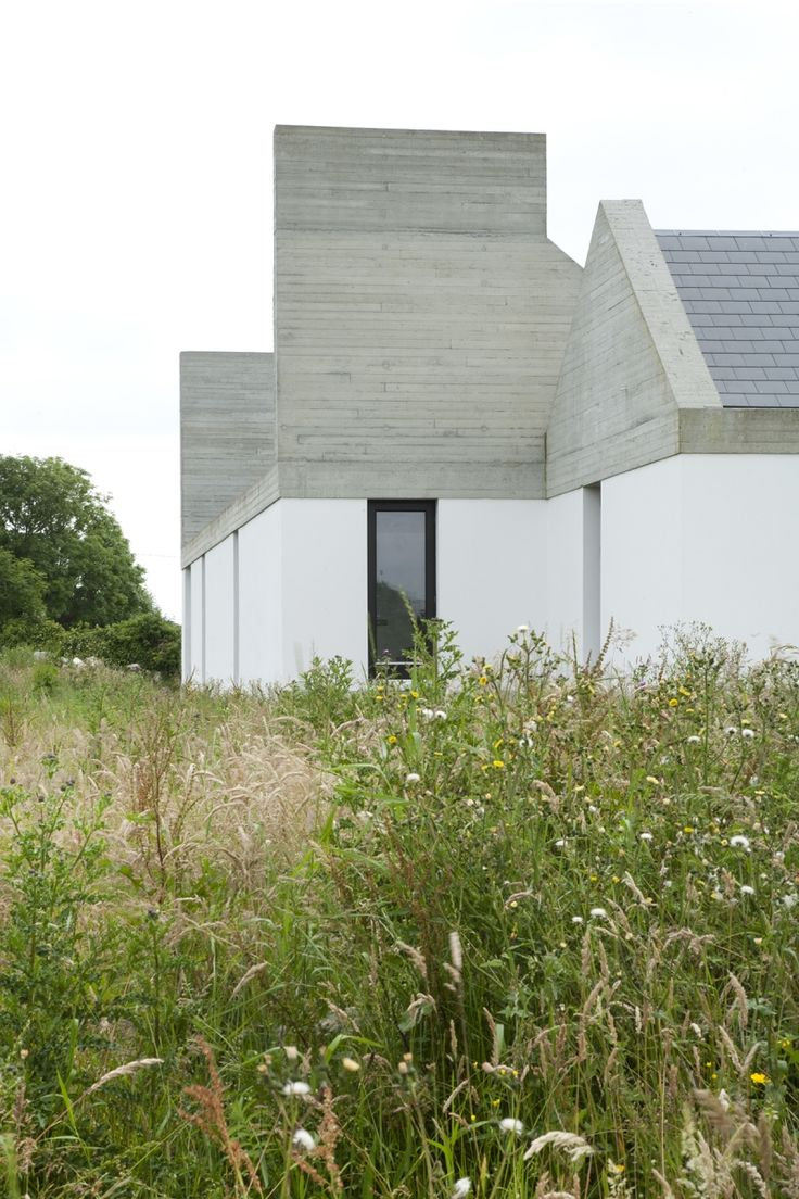 Leaun House, Ryan Kennihan architect, Galway-- use of board faced concrete and traditional shapes in a contemporary reinterpretation of a vernacular farmhouse