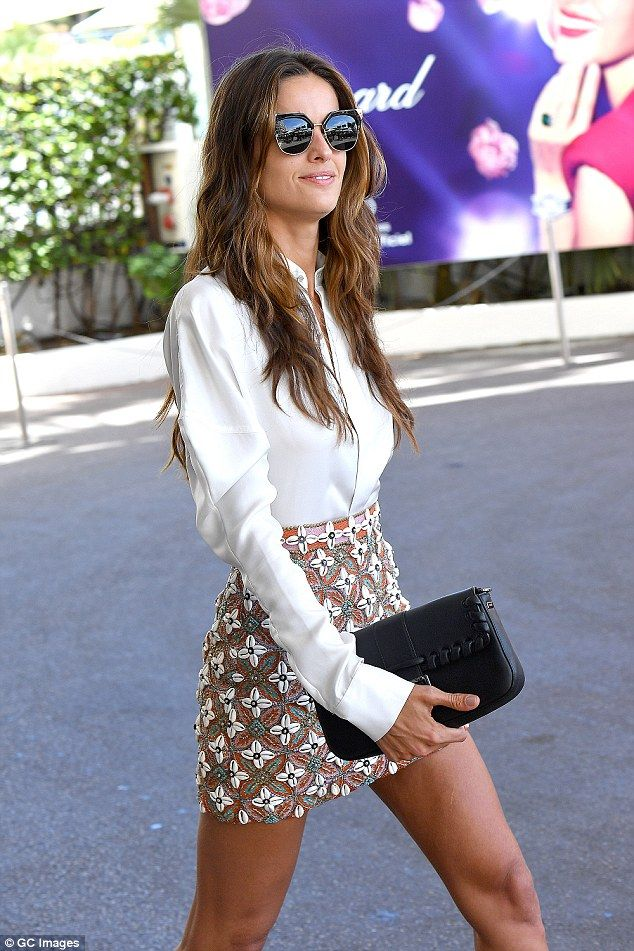 Business chic: Izabel smartened up her look with a stylish white shirt with statement, oversized shoulders