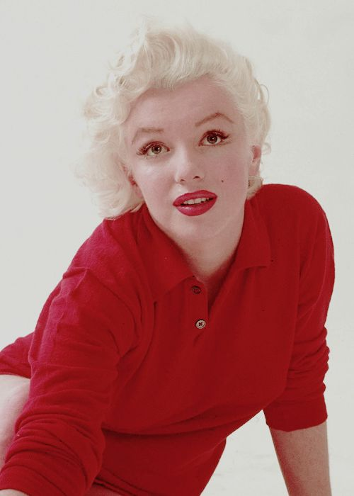 marilyn red sweater sitting photo by milton greene 1955