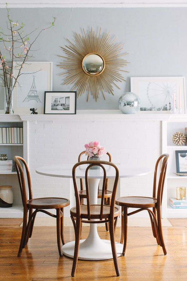 sunburst mirror, simple kitchen, bentwood chairs, tulip table, gray walls, clean palette
