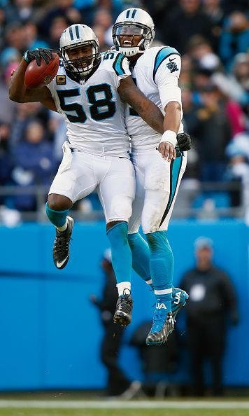 Quarterback Cam Newton #1 and Thomas Davis of the Carolina Panthers celebrate their win after defeating the Seattle Seahawks 31-24 in the NFC Divisional Playoff Game on January 17, 2016 in Charlotte, North Carolina.