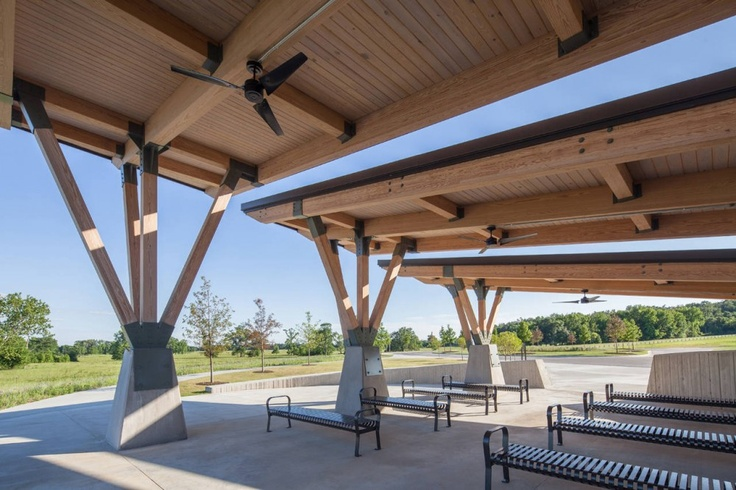 Glue-laminated wood framed superstructure supported by either wood columns on concrete bases.  - Arkansas State Veterans Cemetery at Birdeye / Fennell Purifoy Architects