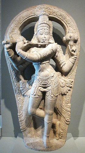 The Hindu deity Krishna playing the flute, 1400-1500 AD Indiia, Granite, San Francisco Asian Art Museum