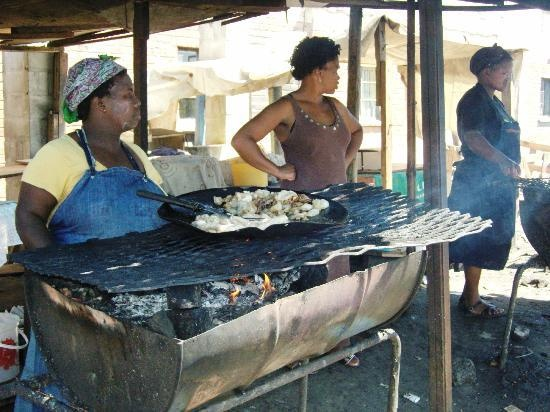 Women selling some freshly made food in a township in Cape Town