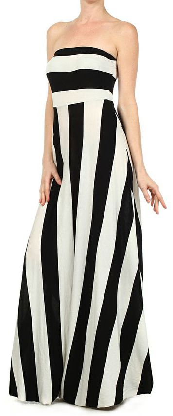 A totally chic maxi, perfect for any season! Features a wrap around with adjustable strings, black and white stripes and a flowy maxi length.