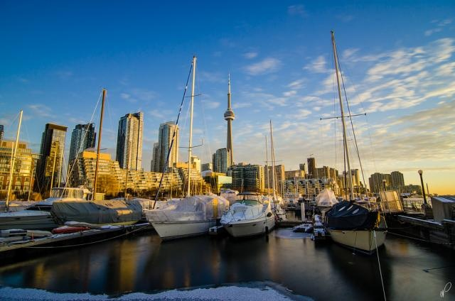 the Toronto Marina on a sunny winter morning. The boats covered with tarp, the ice forming over Lake Ontario, and the CN Tower peaking in the background makes this photo a great selection. The Toronto waterfront will sure look more active during the summer months.