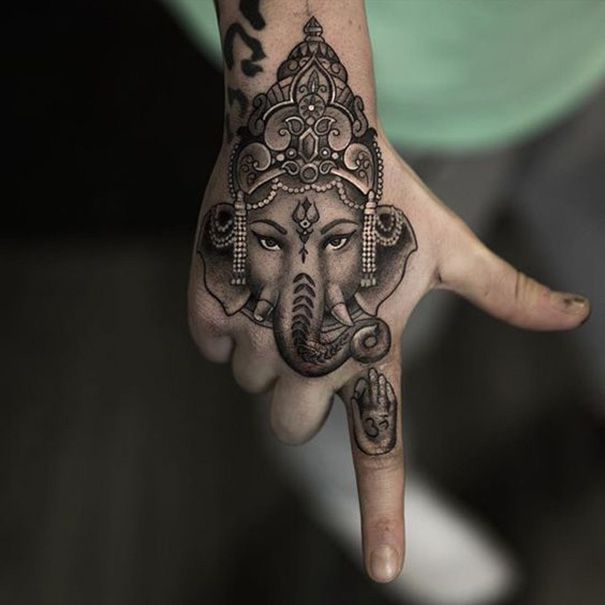 hindu-tattoo on hand