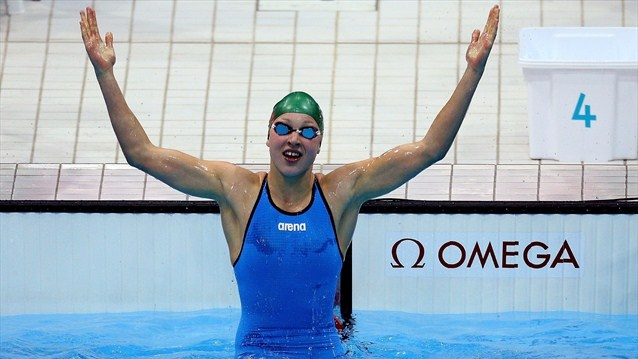Ruta Meilutyte of Lithuania celebrates after she won the final of the women's 100m Breaststroke