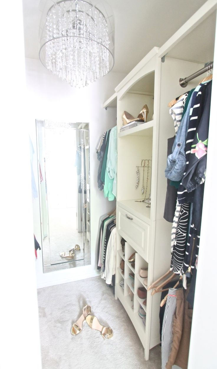 A step in closet converted to a custom walk-in closet with kits from Lowe's - an easy DIY afternoon project!