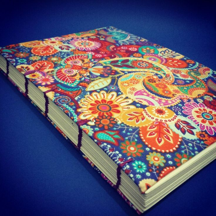 Caderno copta com capa em tecido. E 100 folhas de miolo marfim 75g