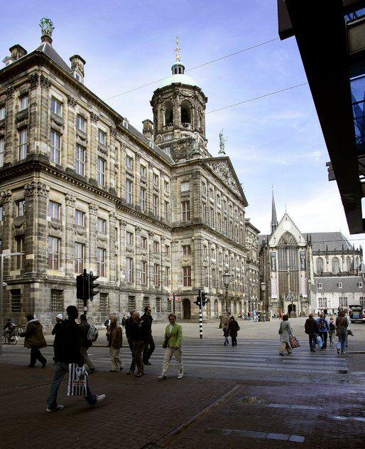 Royal Palace and Nieuwkerk Dam Square Amsterdam - Nieuwe Kerk in the background.
