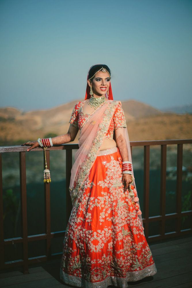 Real Indian Weddings - Neha and Sagar | WedMeGood | Coral Wedding Lehenga with Silver Embroidery and Light Pink Dupatta, Polki Set #wedmegood #lehenga #bridal #realwedding #indianbride #indianwedding #coral