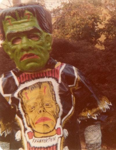 Vintage photo of Halloween trick or treater dressed in a Frankenstein's monster mask & costume