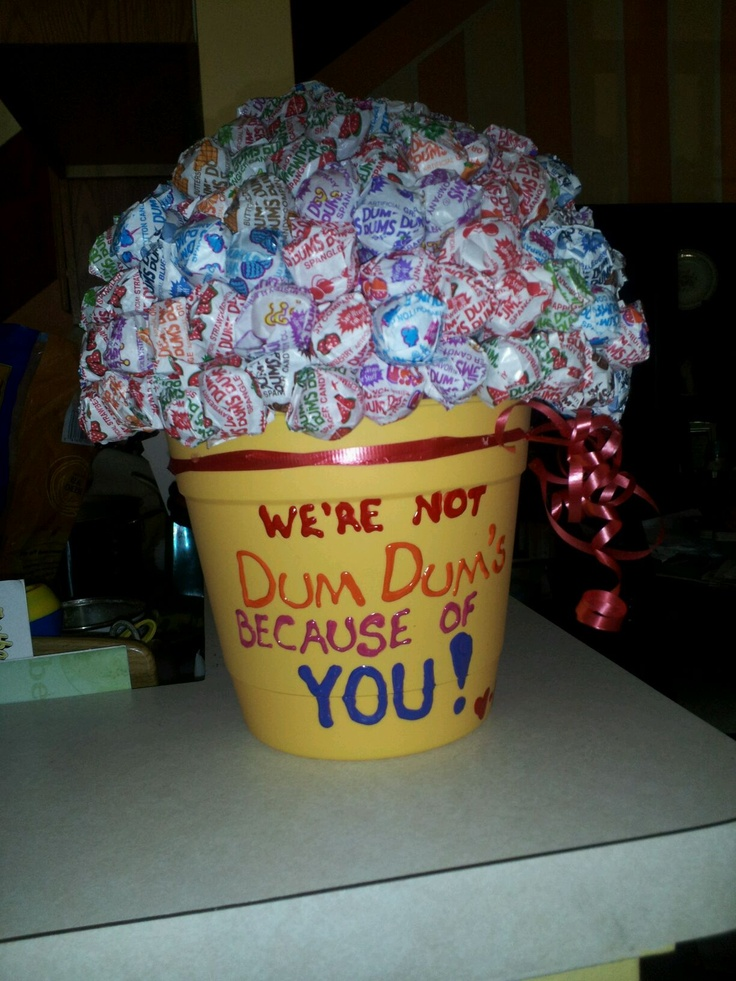 in a flower pot. then my son and i stuck about 250 dum dum lollipops ...