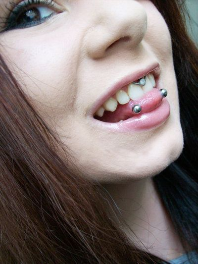 snake eyes and smiley. I don't like either of these.lol, but she is cute enough to pull them off:)