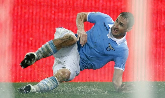 SS Lazio\'s Miroslav Klose celebrates after scoring against AS Roma during their Italian Serie A soccer match in Rome