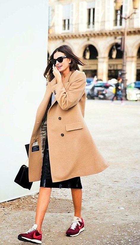 camel coat, burgundy sneakers, black skirt, grey t-shirt