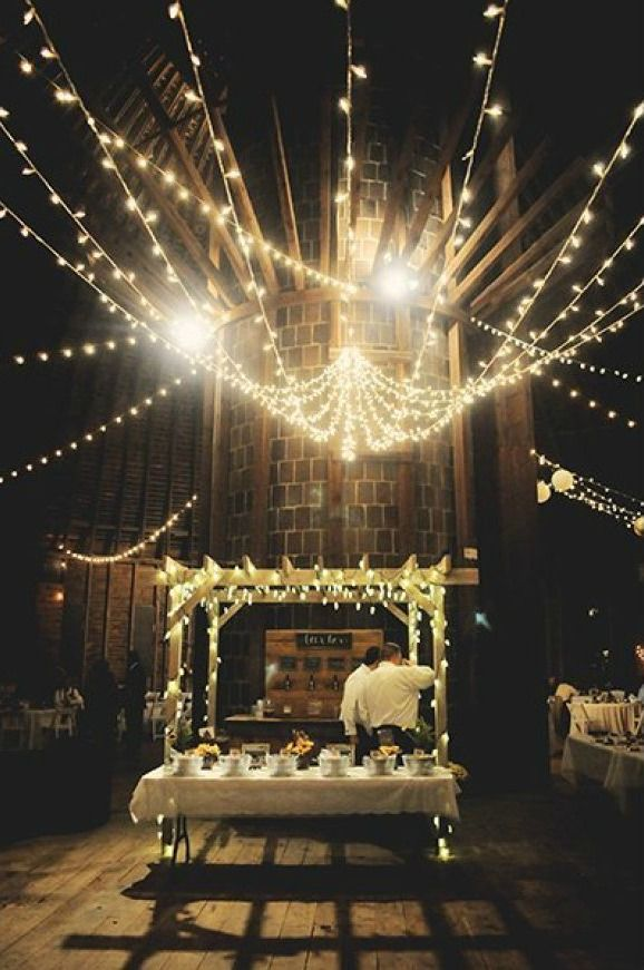 A canopy of twinkling lights creates a romantic ambiance | Lauren R. H. Campbell Photography