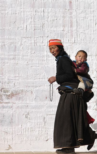 Tibetan pilgrims during the Tibetan New Year, Losar.  Photo taken in Gansu, Tibet, China by Boaz