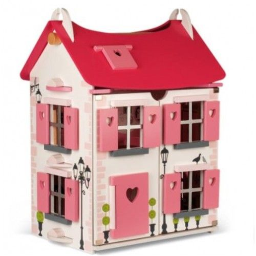 Janod - Maison with Furniture: This beautiful wooden doll house, from French toy maker Janod, features bright and colourful styling in a strawberry theme and comes complete with 17 pieces of furniture for a bedroom, kitchen, living room and bathroom. The exterior features working shutters and doors and a hinged front which allows easy access to play inside. The attic rooms have velux windows and the roof is removable. #alltotstreasures #janod #dollshouse #dolls #woodendollshouse