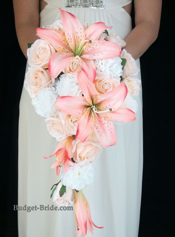 Cascading Coral and Peach Wedding Bouquet with white carnations, peach roses and accented with beautiful Coral Lillies / http://www.deerpearlflowers.com/cascading-wedding-bouquets/