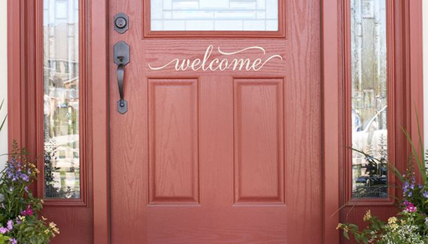 Welcome signs on the front door make the home feel inviting.