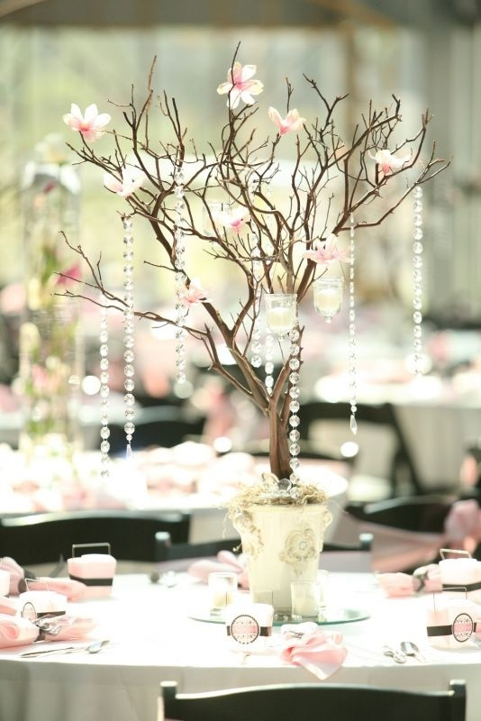 DYI centerpiece :  also cute idea to hang table seating cards for guests