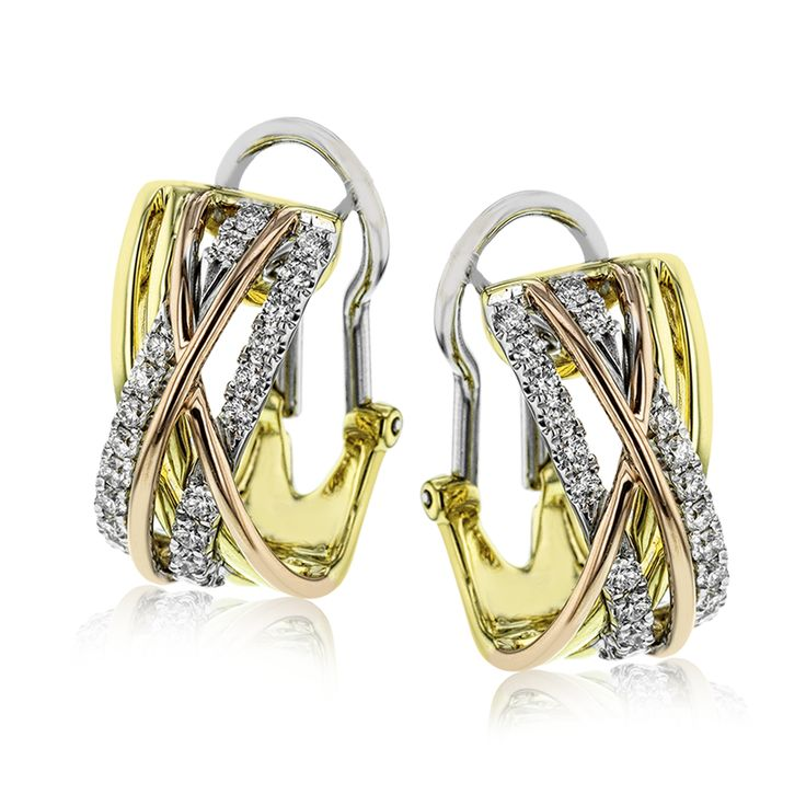 These gorgeous, contemporary earrings glimmer with .74 ctw of round white diamon...