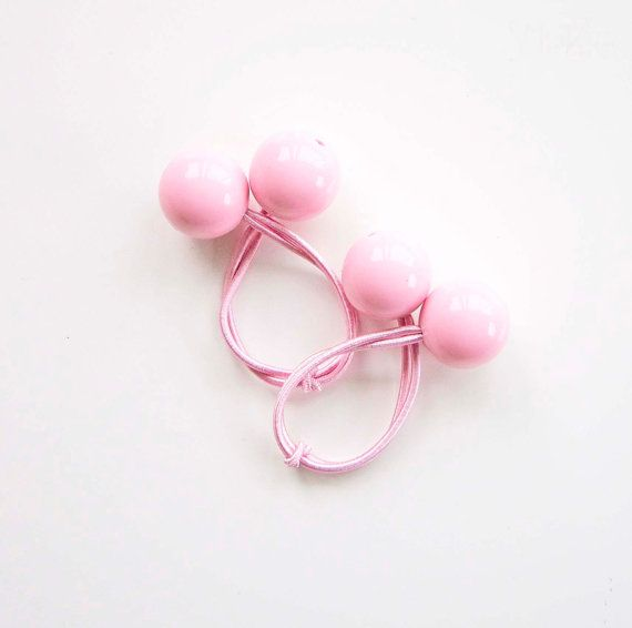 Hair ties, Hair elastics, Ponytail holders, Bobbles. Pink.  If you can remember the 80s you will remember these easy to use and good looking Hair bobbles.
