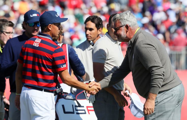 Rickie Fowler Photos Photos - Captain Darren Clarke of Europe shakes hands with Rickie Fowler of the United States during morning foursome matches of the 2016 Ryder Cup at Hazeltine National Golf Club on October 1, 2016 in Chaska, Minnesota. - 2016 Ryder Cup - Morning Foursome Matches