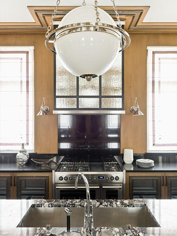 Kitchen.  Countertops made of granite.  Lamp Modern Globe Pendant, Circa Lighting.  Stove, De Dietrich.  Sanitary fittings, Dornbracht.