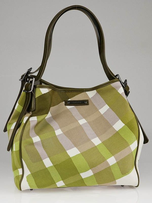 The house of Burberry has a knack for creating tote bags with a twist. This Burberry Citrine Check Canvas Cantebury Tote Bag features a unique green check pattern that mimics paint strokes and contrast olive green leather trim that create an effortlessly stylish look that will elevate any look.  This bag is wonderfully spacious and can accommodate all of your essentials and more.