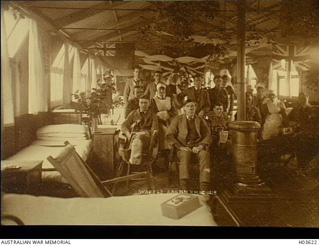 Harefield, England. 1918-12-25. Patients and staff of Ward 43, No 1 Australian Auxiliary Hospital, grouped together in their Christmas decorated ward.
