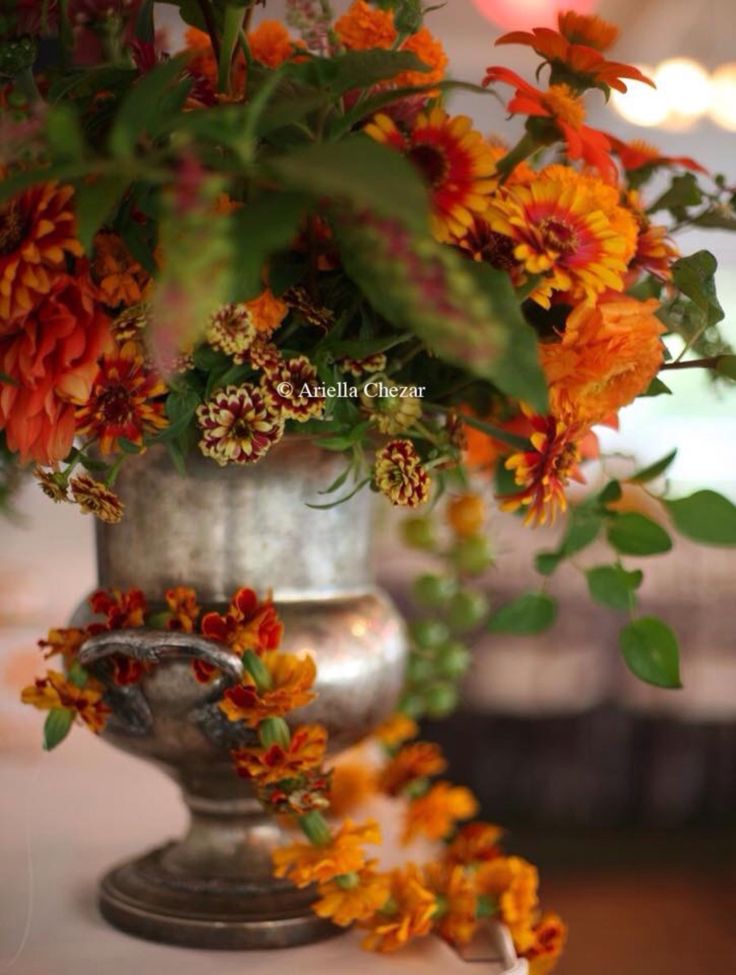 The gorgeous patina on this trophy vase looks beautiful with this autumnal arrangement!  Moment's