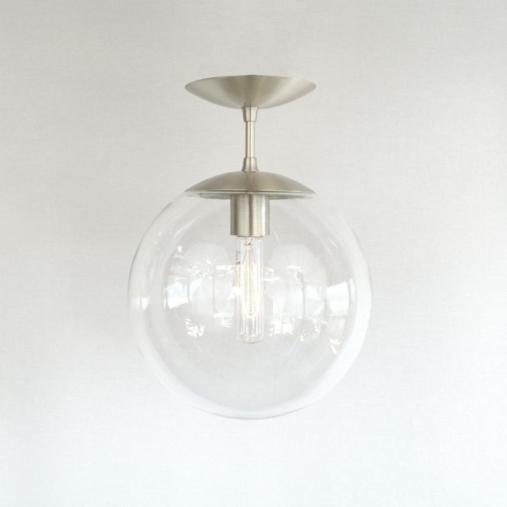 """Mid Century Modern Clear 10"""" Globe Semi Flush Pendant Light With it's flying saucer shaped shade cap and canopy, this fixture perfectly compli..."""
