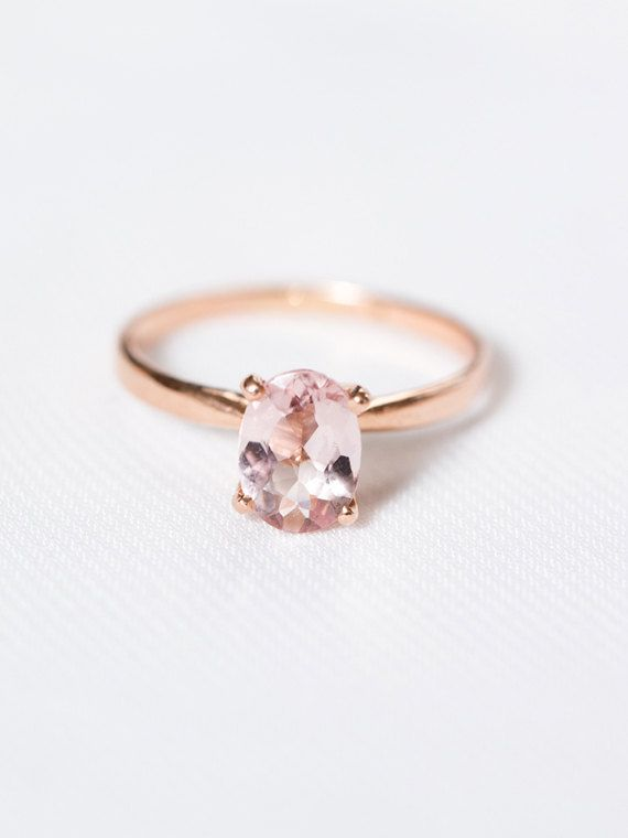 The Geneviève Ring  A flawlessly simple oval blush morganite gem, set atop a tapered 14k gold band. This solitaire engagement ring effortlessly combines classic sophistication with modern style. Geneviève makes a unique, engagement ring and couples perfectly with our Fleur wedding band.  The Fleur Ring: https://www.etsy.com/listing/271253301/rose-gold-eternity-wedding-ring-blush  Please choose your ring size and colour (yellow gold, rose gold, white gold) from the drop down menus.  Also…