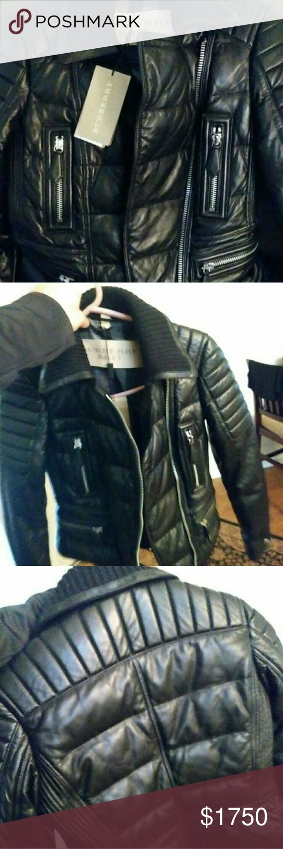 Burberry womans black leather jacket It has black leather with silver zippers and a black soft collar Burberry Brit Jackets & Coats