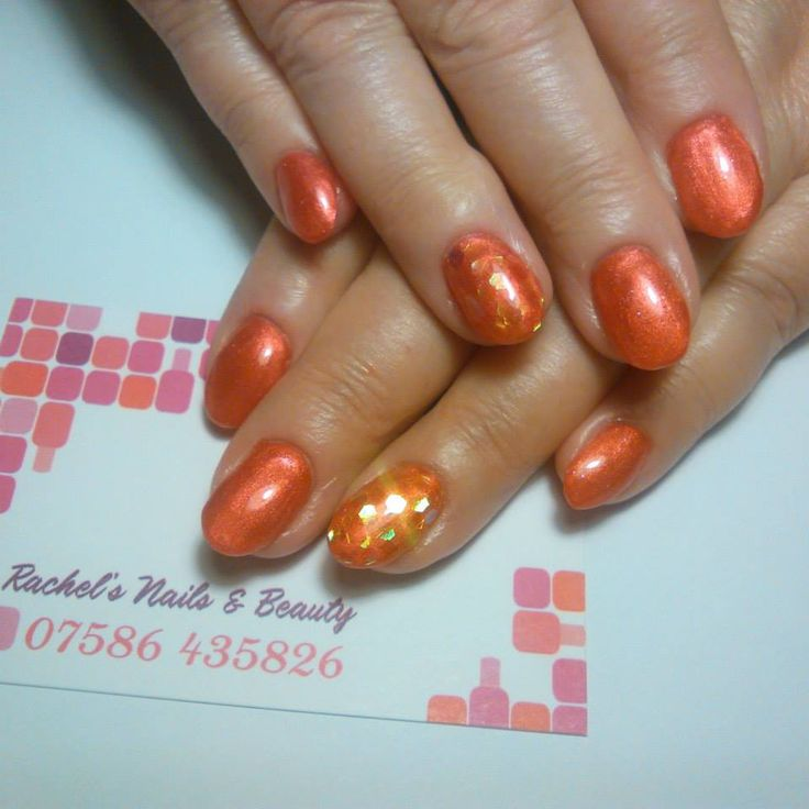 Oval Bio Sculpture Gel sculptured extensions using No. 2058 Desert Sunset with encapsulated glitter pieces.