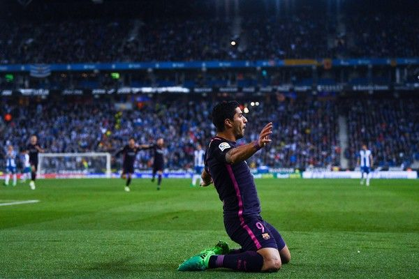 Luis Suarez of FC Barcelona celebrates after scoring the opening goal during the La Liga match between RCD Espanyol and FC Barcelona at the RCDE Stadium on April 29, 2017 in Barcelona, Catalonia.