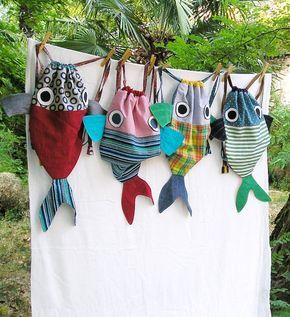 A lined drawstring backpack for children. This Big Fish can carry the nap blanket, the favorite plush, tableware... It can be a very special gift to start school in a good mood :-) Our backpacks are one of a kind pieces made from reclaimed and repurposed fabrics and clothes. Strings are adjustable. Hand or machine wash in cold water. Contact us to receive pictures of the available backpacks in our workshop This listing is for one fish backpack. ................................. SHIPPING:...