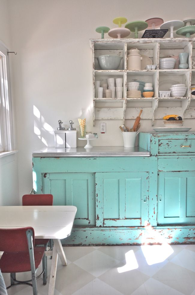 Love the chippy cabinets and the collection of cake stands (pinned from the Vintage Whites Blog)