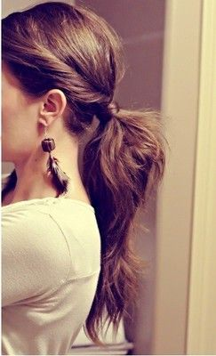 Easy to do, for those typical bad hair days. It kind of looks like half the section was taken and flipped in. Then, the rest of the hair was added to the ponytail and then the first section's ends is wrapped around the entire band and then teased.