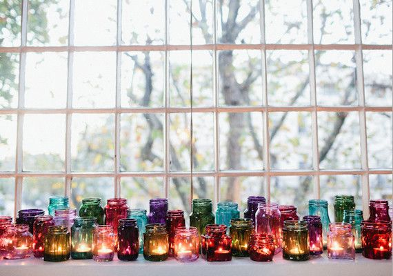 Mixed Jewel Tone Jars and Votives || Bring some color to the table on the wedding day.